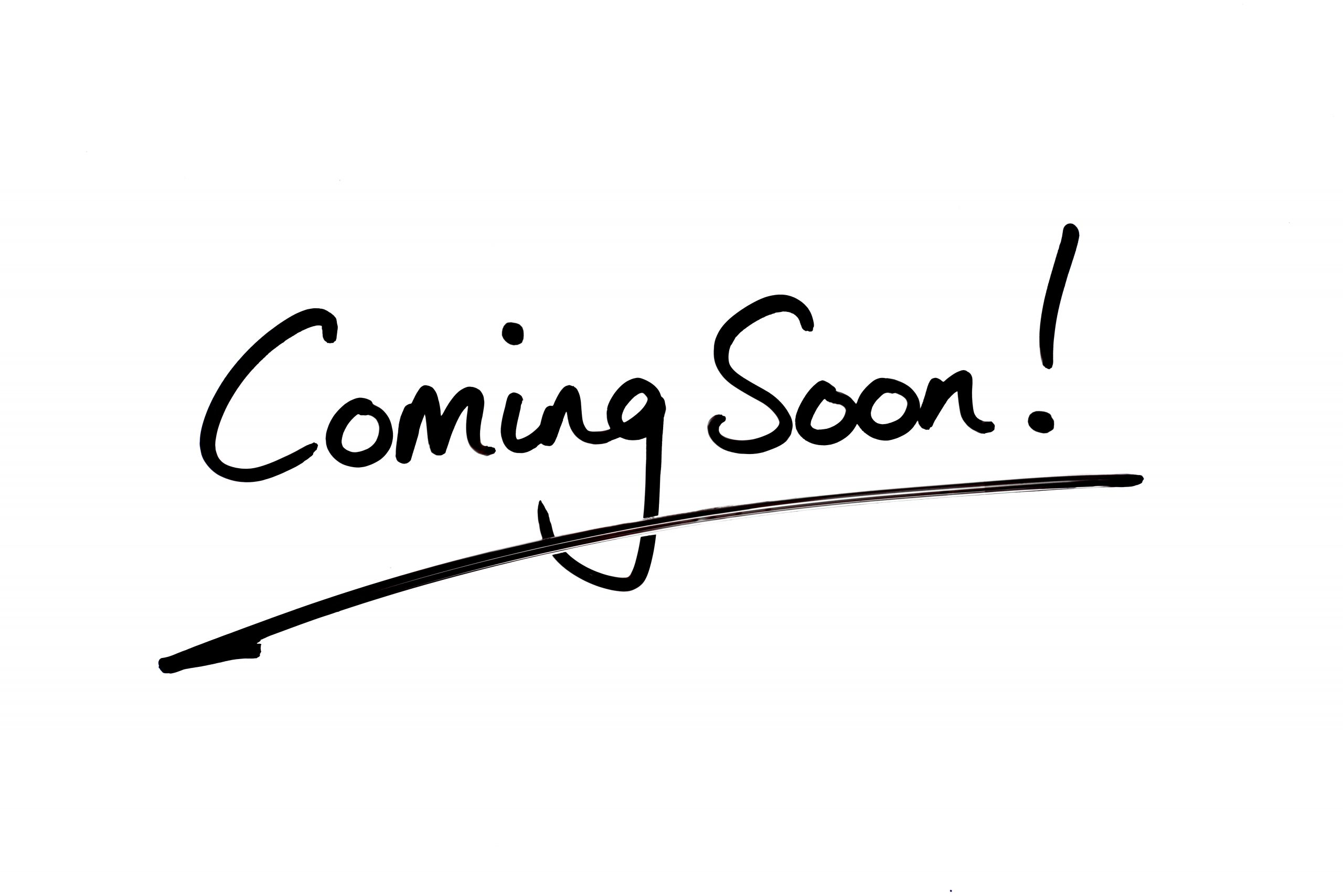 Coming Soon! handwritten on a white background.